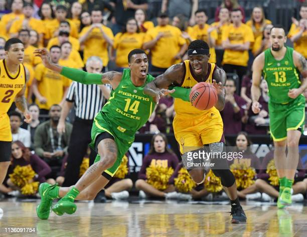 Zylan Cheatham of the Arizona State Sun Devils brings the ball up the court against Kenny Wooten of the Oregon Ducks during a semifinal game of the...