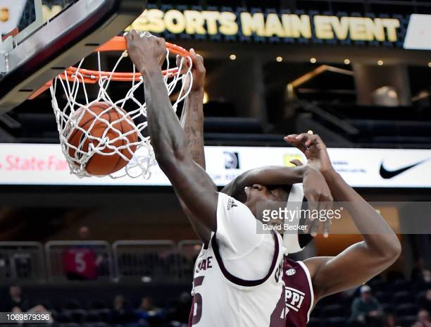 Zylan Cheatham of the Arizona State Sun Devils is fouled as he shoots against Aric Holman of the Mississippi State Bulldogs during the first half of...