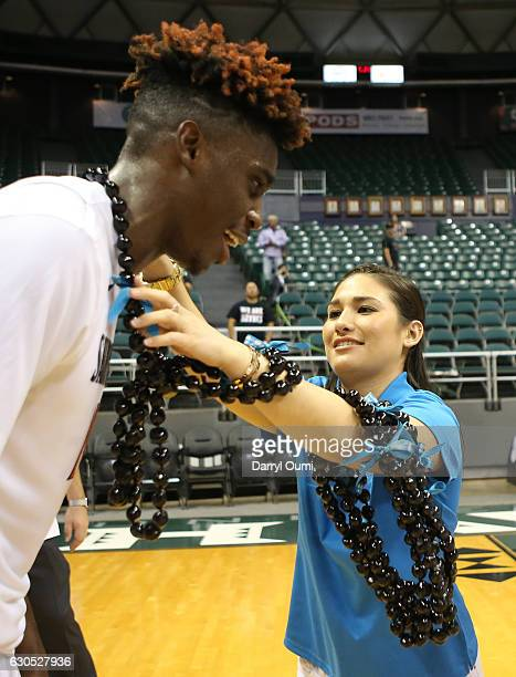 Zylan Cheatham of the San Diego State Aztecs receives a lei after winning the Championship Game of the Diamond Head Classic against the San Francisco...