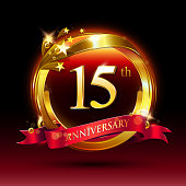 15th golden anniversary logo with ring and red ribbon