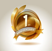 1st anniversary ribbon logo with golden circle and graphic elements