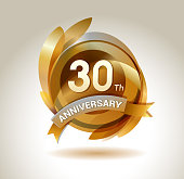30th anniversary ribbon logo with golden circle and graphic elements