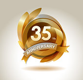 35th anniversary ribbon logo with golden circle and graphic elements