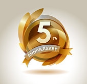 5th anniversary ribbon logo with golden circle and graphic elements