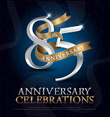 85th years anniversary celebration silver and gold logo with golden ribbon on dark blue background. vector illustrator