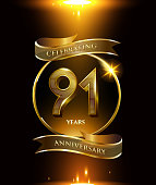 91st years anniversary logo with golden ring and ribbon colored isolated on black background, vector design for party greeting card and invitation card. celebration logotype template