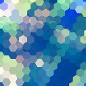 abstract background consisting of blue, green hexagons