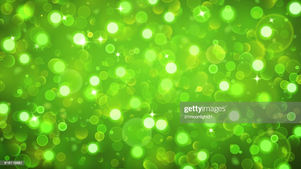 Abstract background with bokeh effect in green