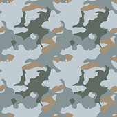 Abstract camo background as urban camouflage in different shades of beige, gray and blue