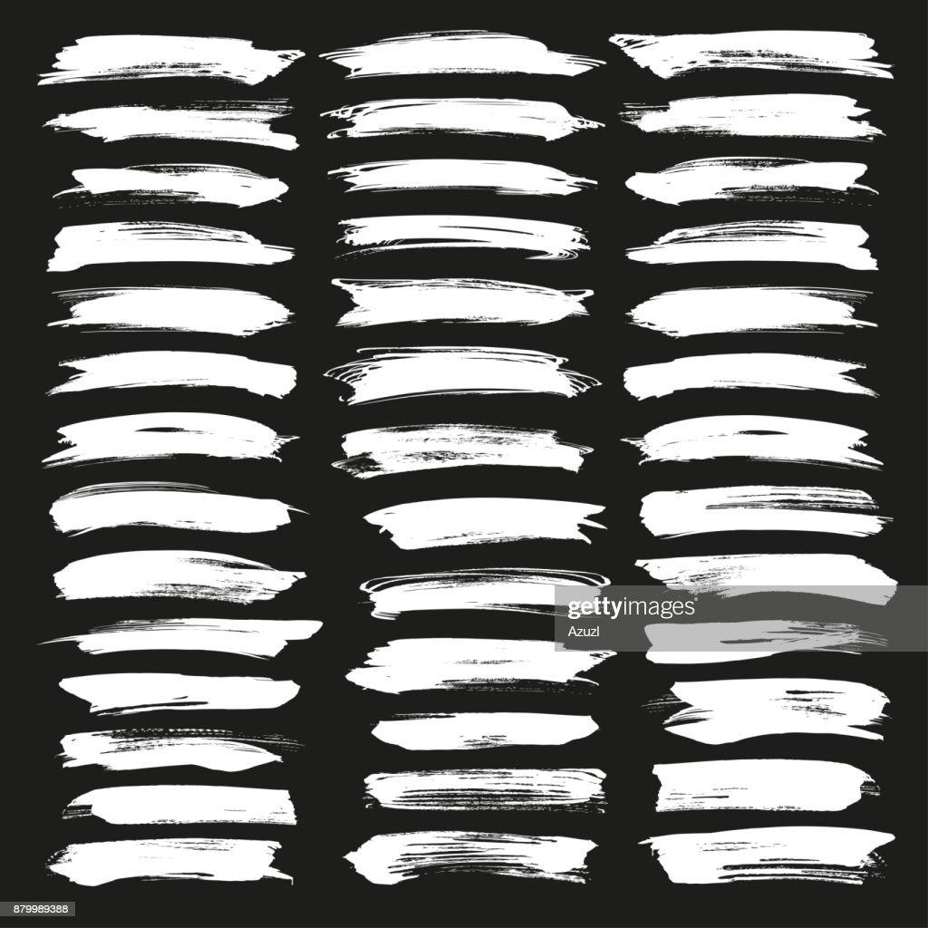 Abstract chalk white vector brush strokes set. Chalk grunge brushes. Grunge illustrator vector brush white on black background