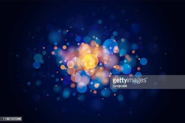 illustrazioni stock, clip art, cartoni animati e icone di tendenza di abstract glittering bokeh circles isolated on dark background. holiday design element. - onirico