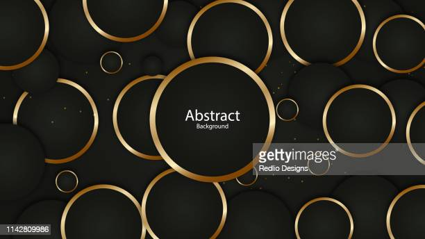 abstract gold rings on black background - ring stock illustrations