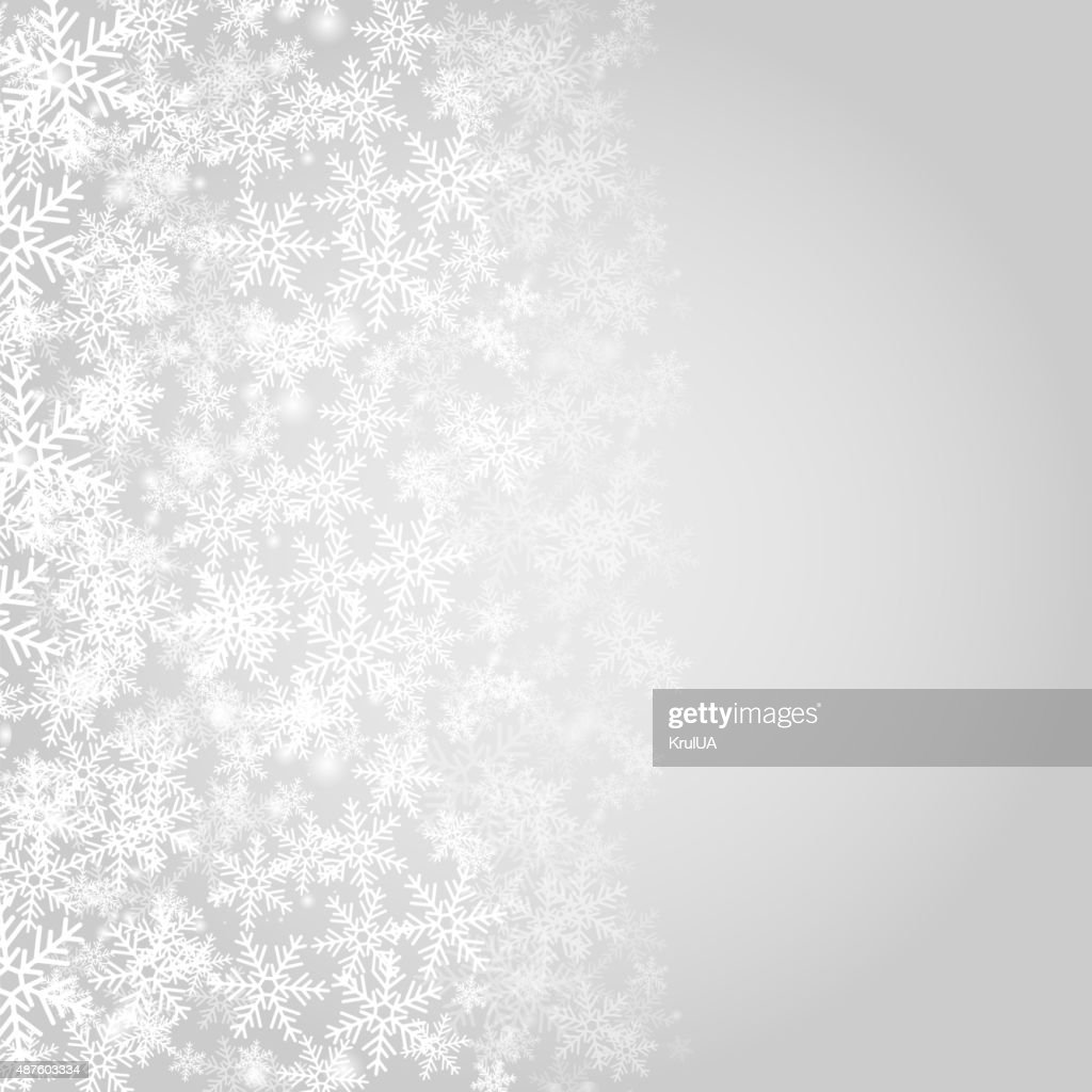 Abstract grey Christmas background with white snowflakes.
