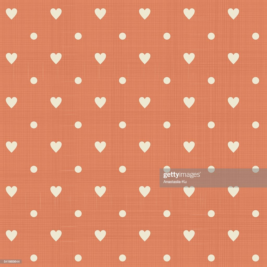 abstract hearts polka dot seamless pattern in faded orange