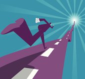Abstract image of businessman running on a road