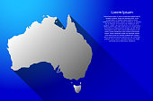Abstract map of Australia with long gradient shadow on blue background of vector illustration