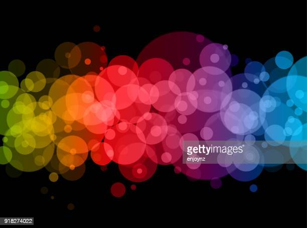 Abstract rainbow dots background