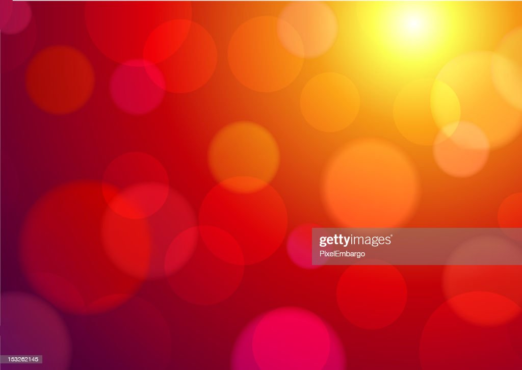 Abstract red spotty background with yellow light