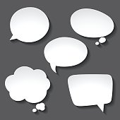 Abstract white paper speech bubbles on gray background