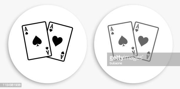 ace of spades and hearts black and white round icon - ace stock illustrations, clip art, cartoons, & icons