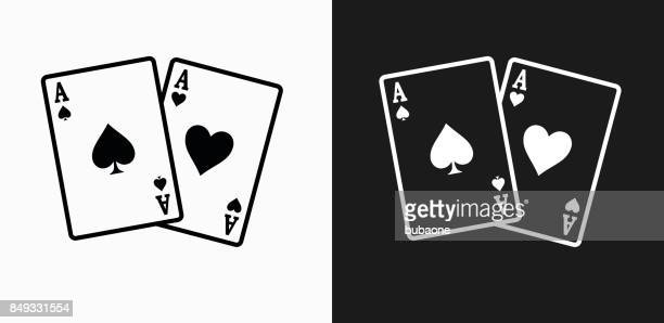 ace of spades and hearts icon on black and white vector backgrounds - ace stock illustrations, clip art, cartoons, & icons