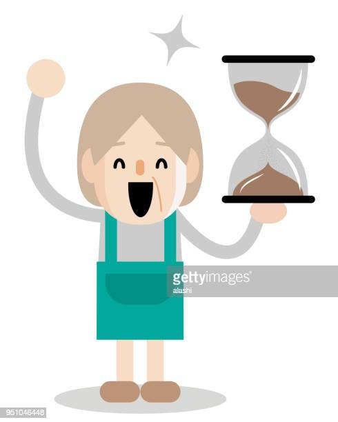 Active and healthy lifestyle senior woman with hourglass sand clock