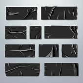 Adhesive or masking tape set. Black rubber insulating tape with folds with ripped edges isolated on background. Fixation or gluing. Repair or packaging theme. Stationery. Vector realistic