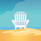 Adirondack chair on the sea beach standing on yellow sand