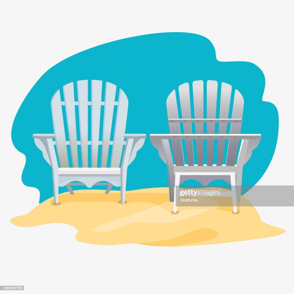 Adirondack chair standing on the yellow sand