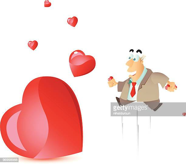Adult man jumping and looking at flying hearts