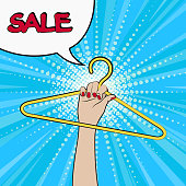 Advertising poster in pop art style. A woman's hand holds a hanger. Speech bubble. Sale.