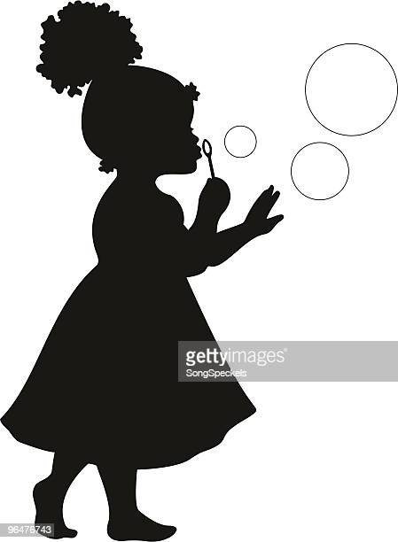 African American Girl Blowing Bubbles