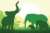 African Safari background with trumpeting elephant, elephant mother and her calfs