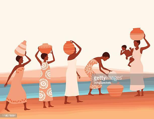 Afrikanische Frauen sammeln Wasser