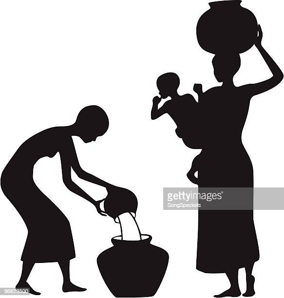 Afrikanische Frauen treffen Wasser
