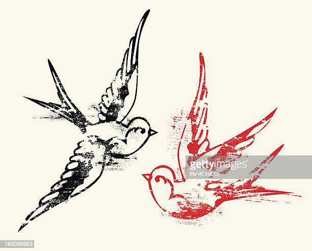 aged tattoo style swallows - woodcut stock illustrations