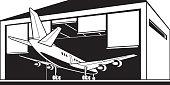 Aircraft enter hangar at airport