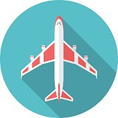 Airplane icon with long shadow.