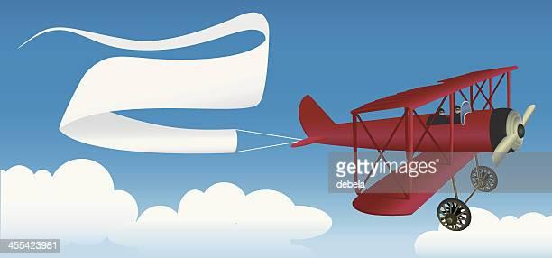 airplane message - biplane stock illustrations, clip art, cartoons, & icons