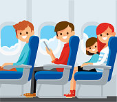 Airplane passengers on their seats.