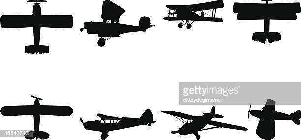 airplane silhouette - biplane stock illustrations, clip art, cartoons, & icons