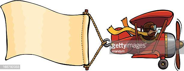 airplane with banner - biplane stock illustrations, clip art, cartoons, & icons