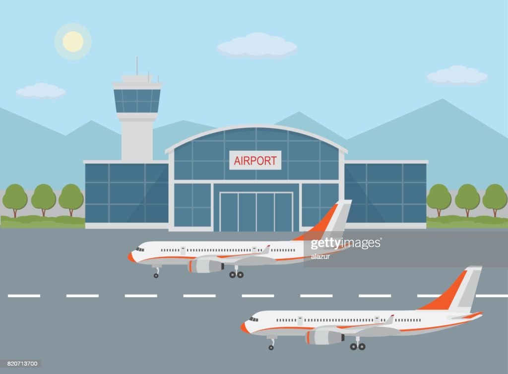 Airport building and airplanes on runway.