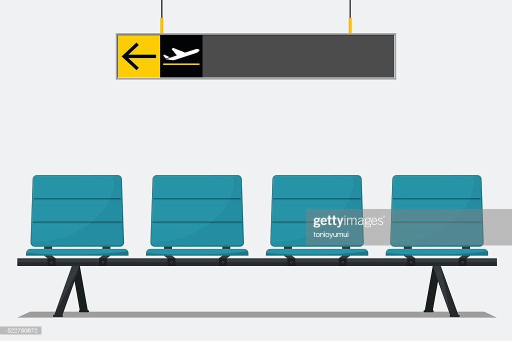 Airport seat in waiting area and wayfinding signage.