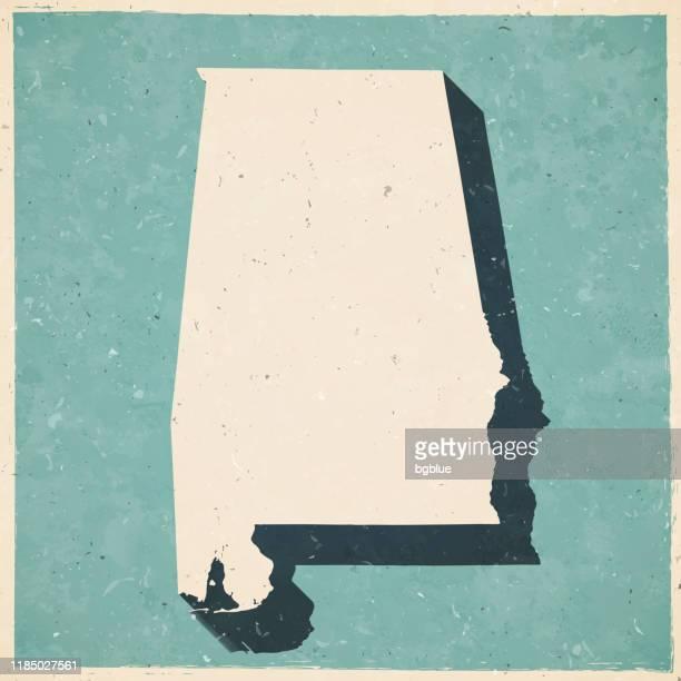 bildbanksillustrationer, clip art samt tecknat material och ikoner med alabama karta i retro vintage stil-gammalt texturerat papper - alabama