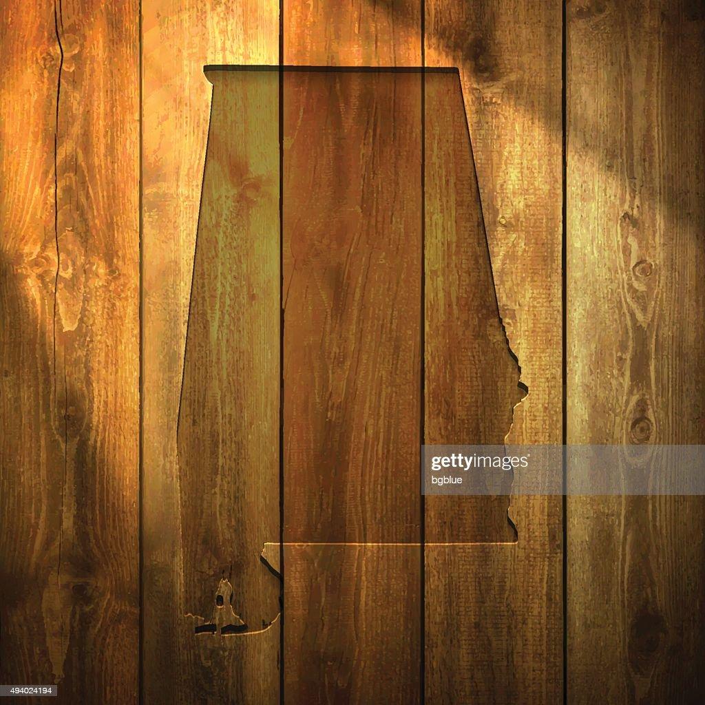 Alabama Map on lit Wooden Background