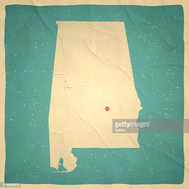 alabama map on old paper - vintage texture - alabama stock illustrations, clip art, cartoons, & icons