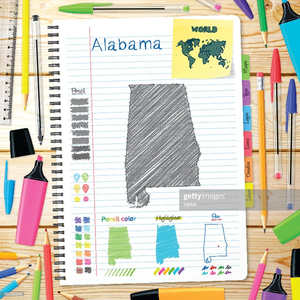 Alabama maps hand drawn on notebook. Wooden Background