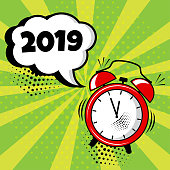 Alarm clock with white comic bubble with 2019 word on green background. Comic sound effects in pop art style. Vector illustration.