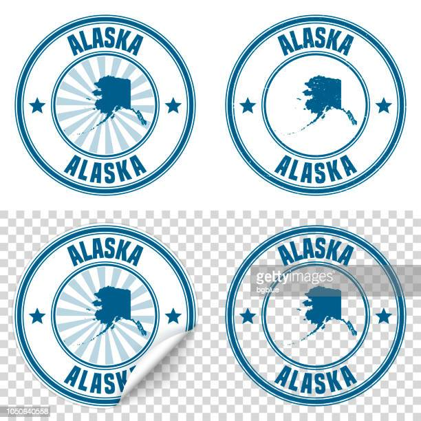 alaska - blue sticker and stamp with name and map - alaska us state stock illustrations